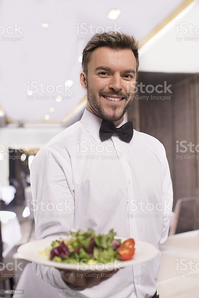 Cheerful waiter. stock photo