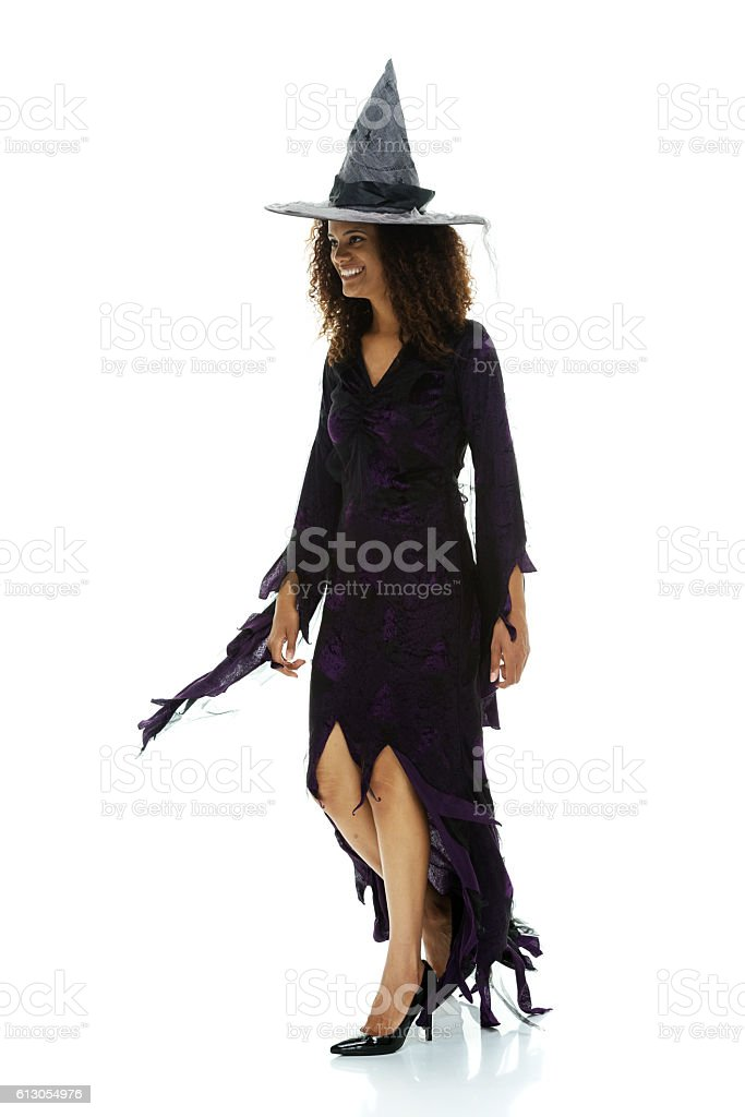 Cheerful witch walking stock photo