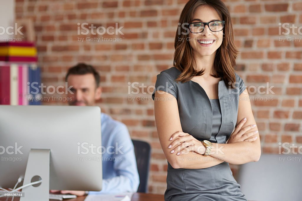 Cheerful woman and her work colleague stock photo