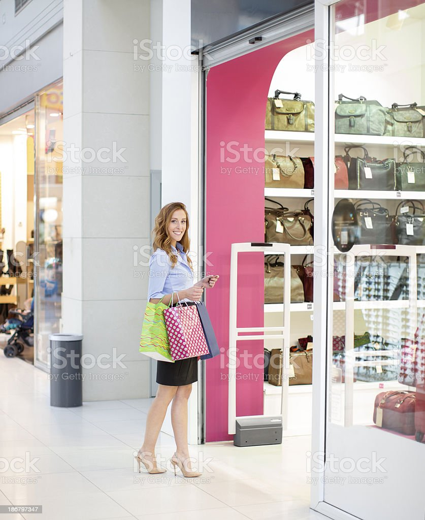 Cheerful woman at shopping mall. stock photo