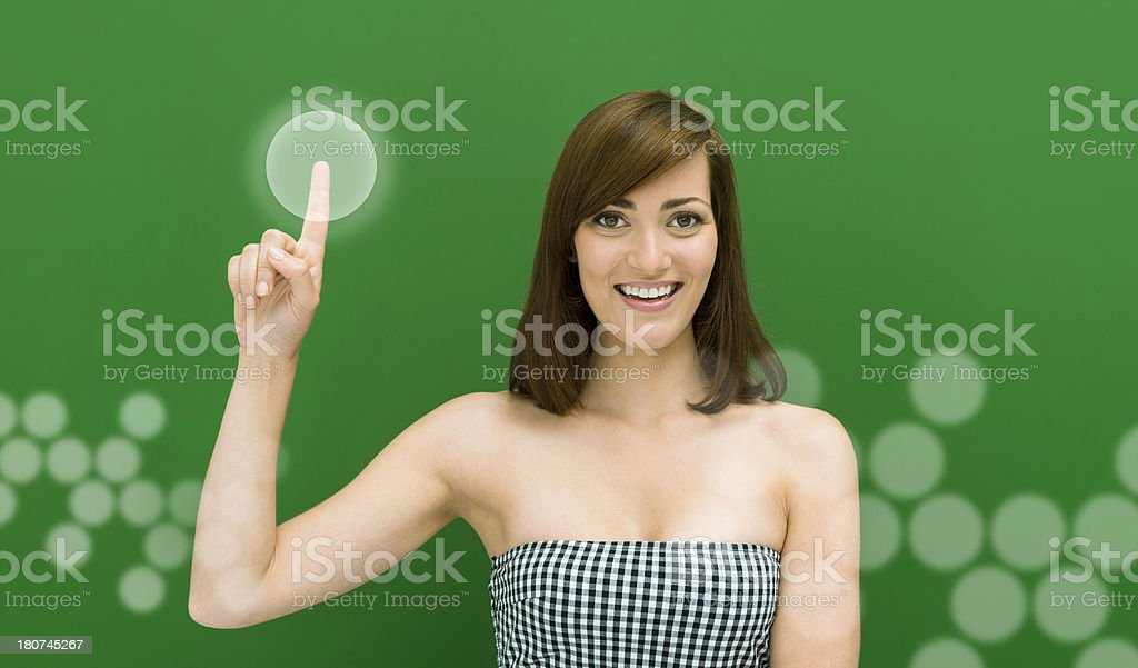 Cheerful woman clicking virtual button royalty-free stock photo