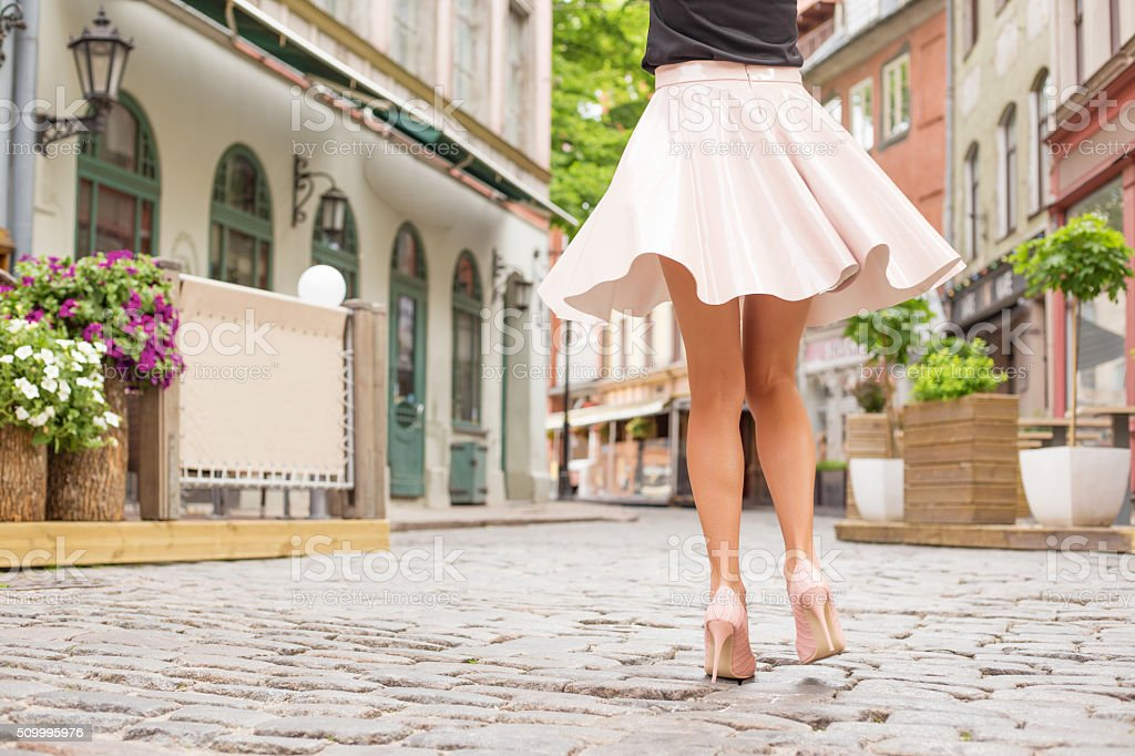 Cheerful woman dancing on the street stock photo