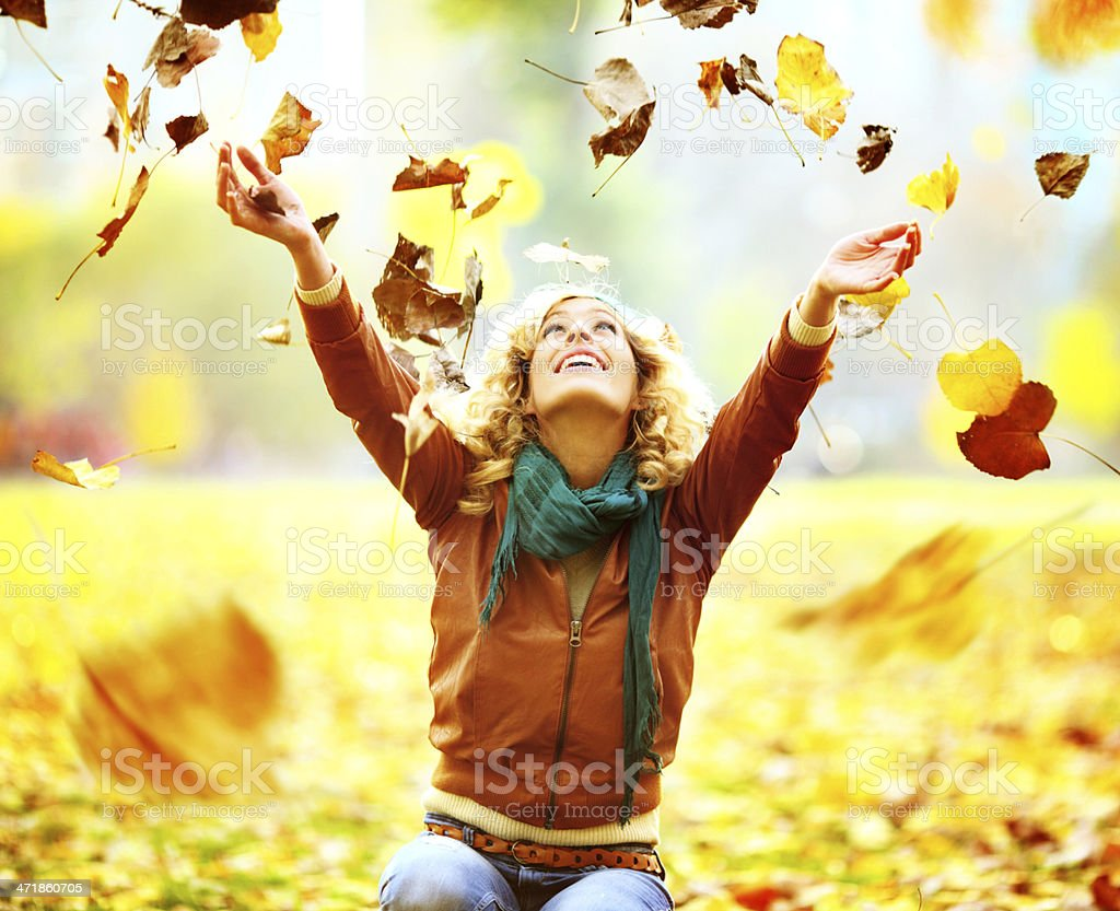 Cheerful woman enjoying autumn day in park royalty-free stock photo
