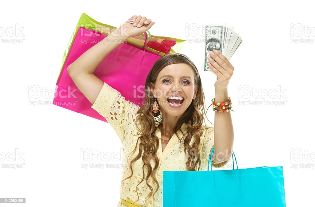 Cheerful woman excited by money stock photo