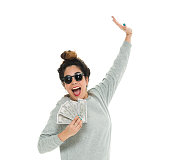 Cheerful woman excited by money