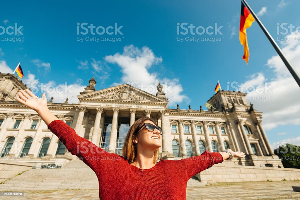 Cheerful woman feels happiness near Bundestag in Berlin, Germany stock photo