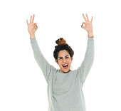 Cheerful woman giving ok sign