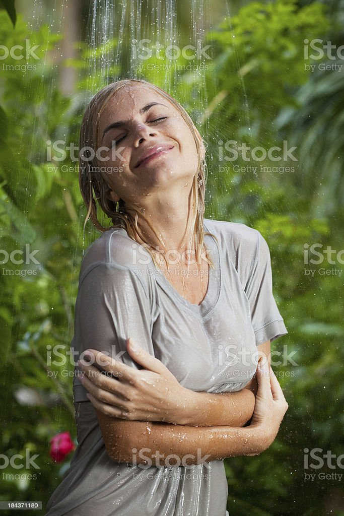 Cheerful woman having a shower in the tropical nature royalty-free stock photo