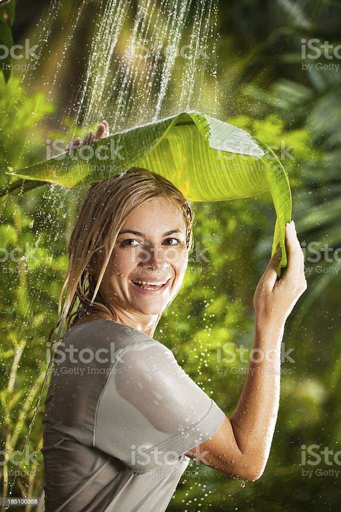 Cheerful woman having a shower outdoors royalty-free stock photo