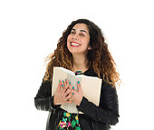 Cheerful woman holding books