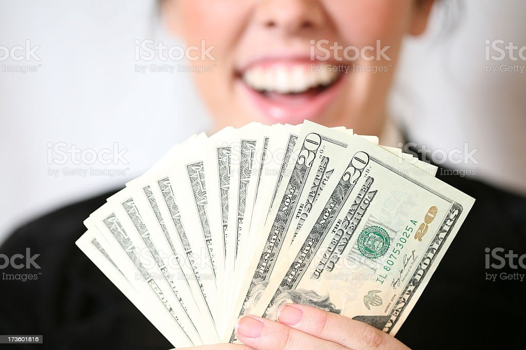 Cheerful Woman Holding Money stock photo