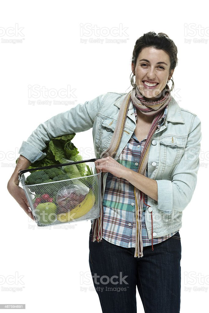Cheerful woman holding vegetable basket royalty-free stock photo