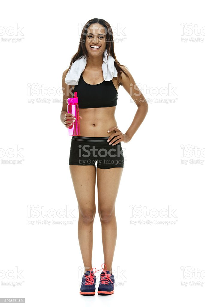 Cheerful woman holding water bottle stock photo
