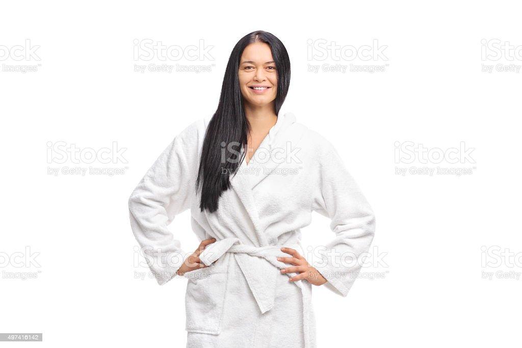 Cheerful woman in a white bathrobe stock photo