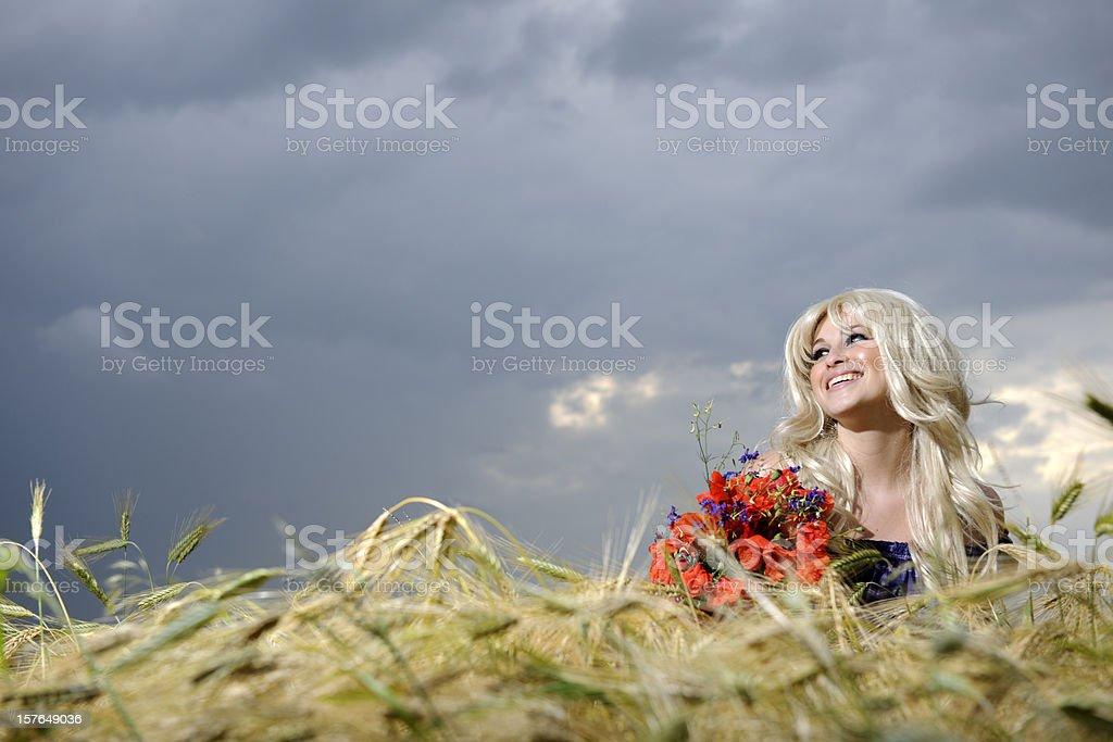 cheerful woman in corn field royalty-free stock photo