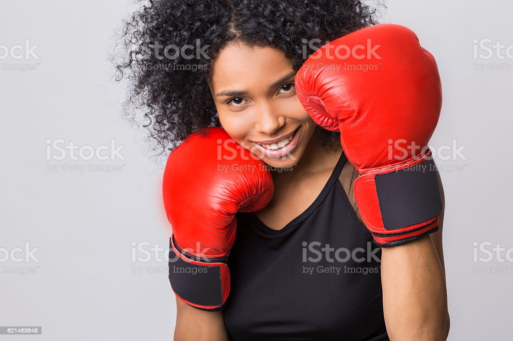 cheerful woman in fight stand with red boxing gloves stock photo