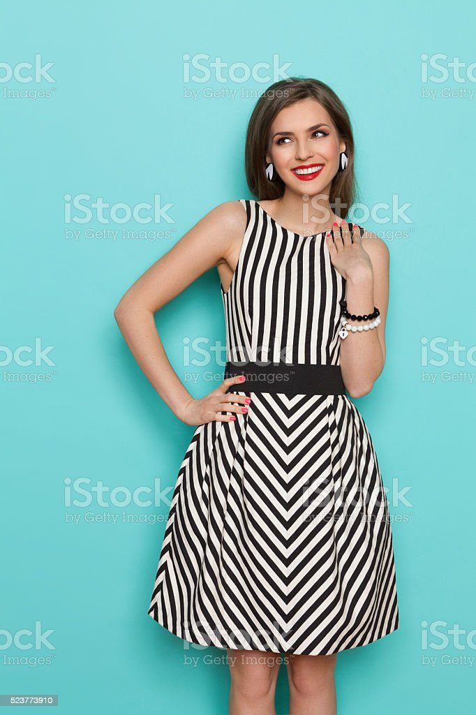 Cheerful Woman In Striped Dress stock photo