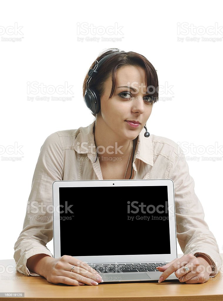 Cheerful woman in the headset and with a computer royalty-free stock photo