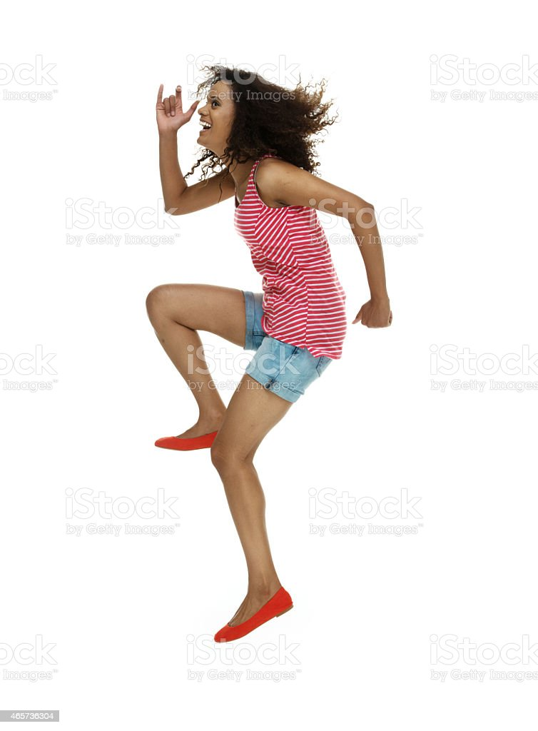 Cheerful woman jumping and laughing stock photo