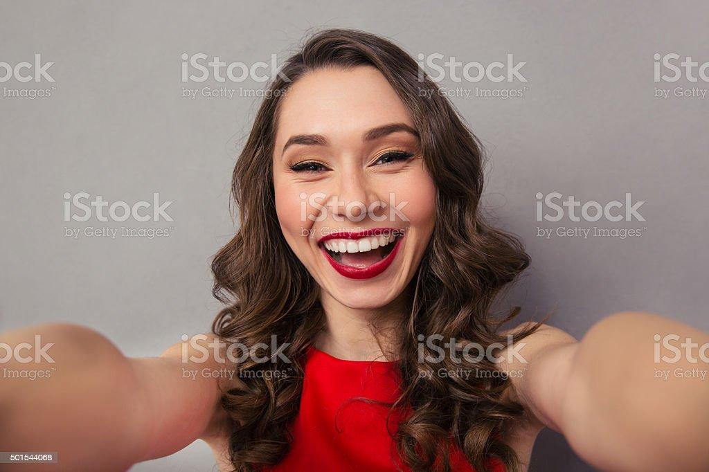 Cheerful woman making selfie photo stock photo