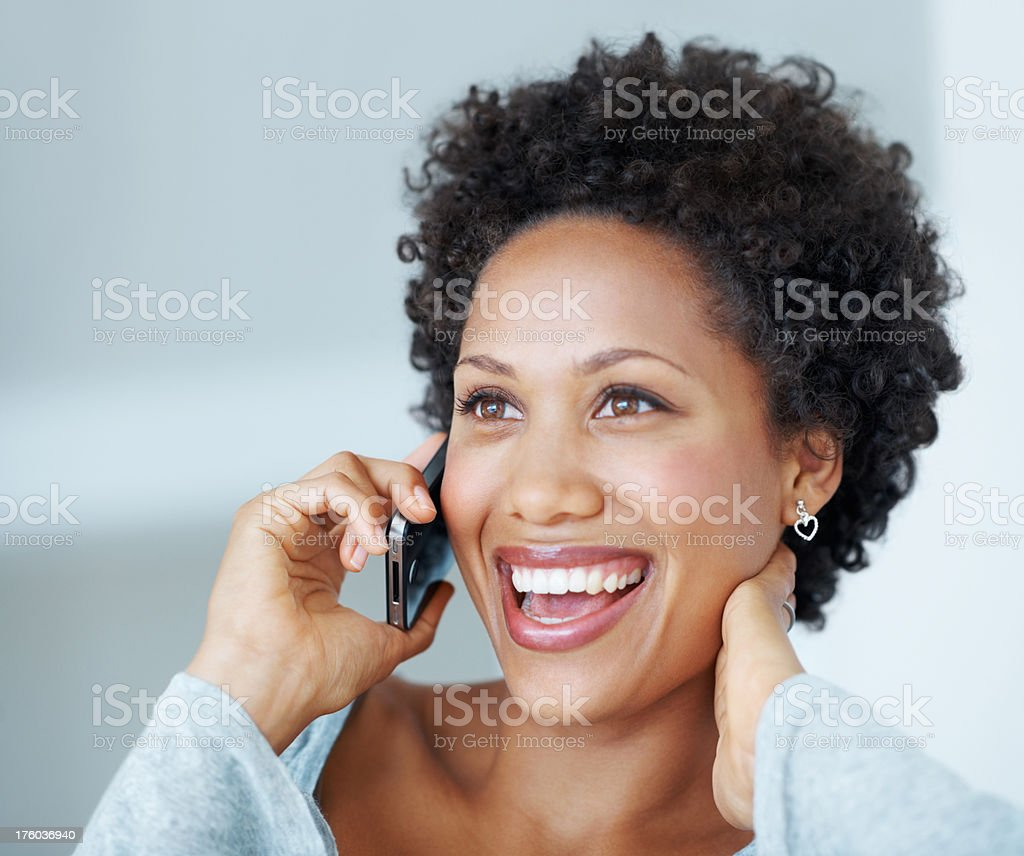 Cheerful woman on phone stock photo
