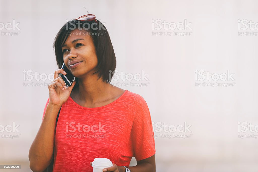 Cheerful woman on the phone stock photo