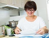 cheerful woman paying bills