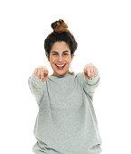 Cheerful woman pointing at camera