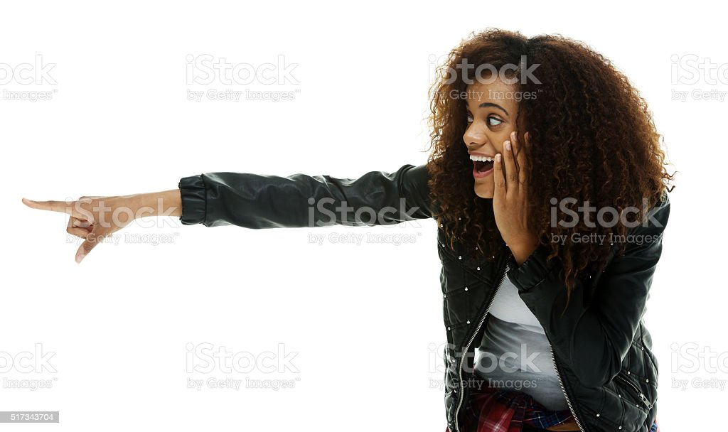 Cheerful woman pointing away stock photo
