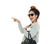 Cheerful woman pointing away