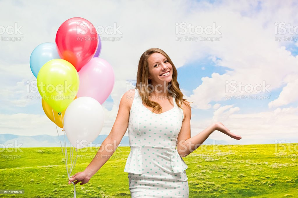 Cheerful woman presenting outdoors stock photo