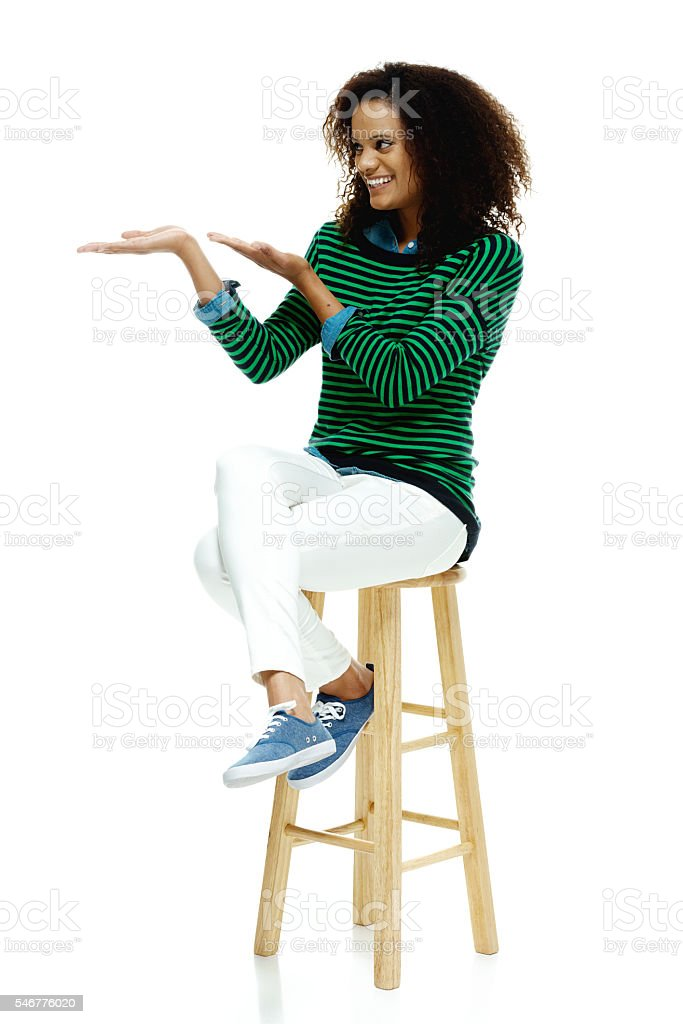 Cheerful woman presenting stock photo