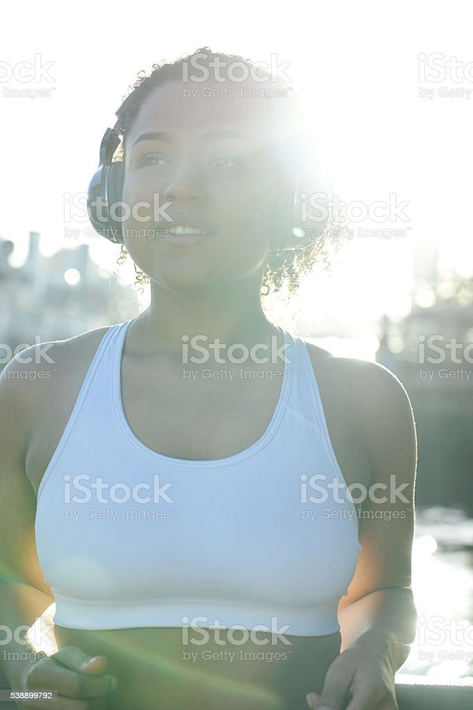 Cheerful Woman Relaxing After Workout stock photo