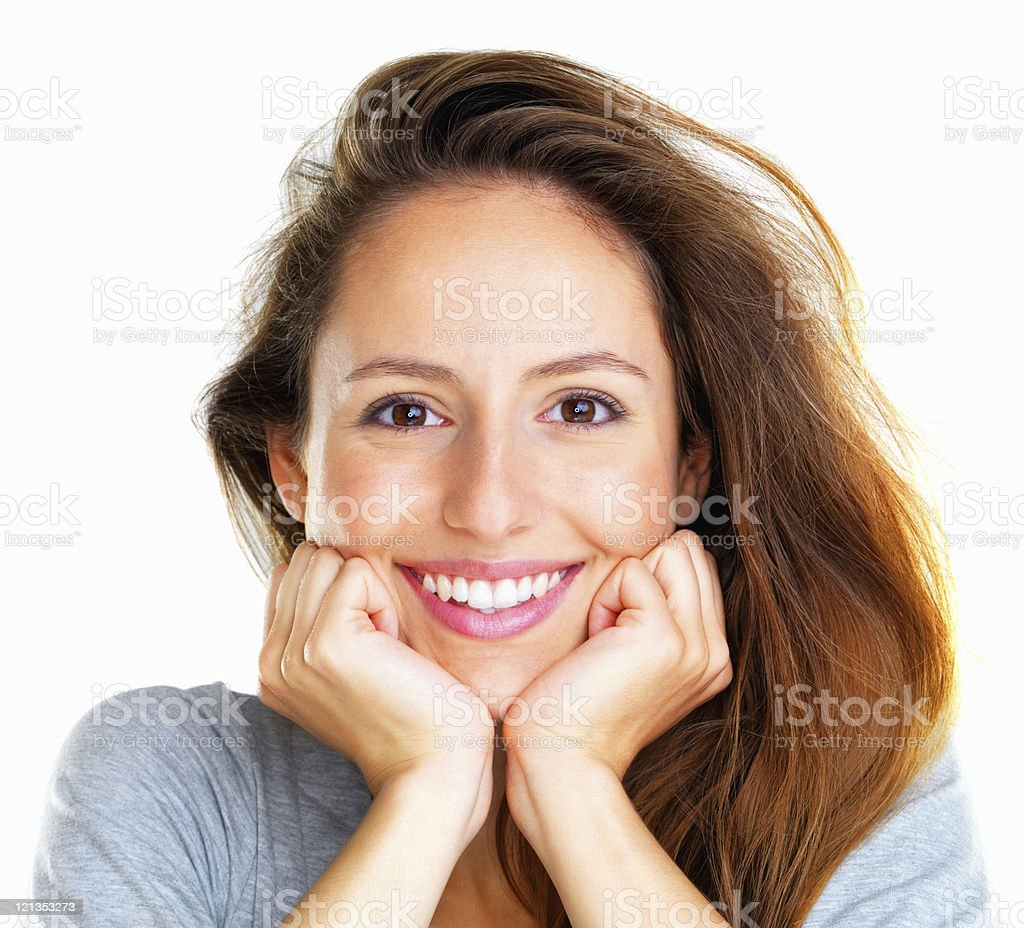 Cheerful woman resting face in hands royalty-free stock photo