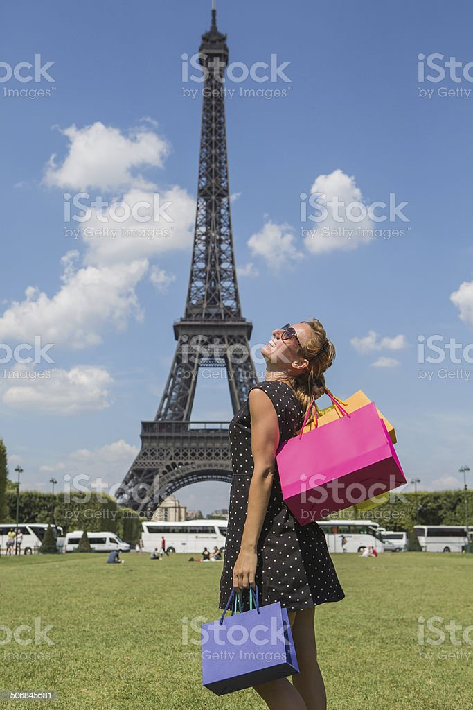Cheerful woman shopping in Paris stock photo