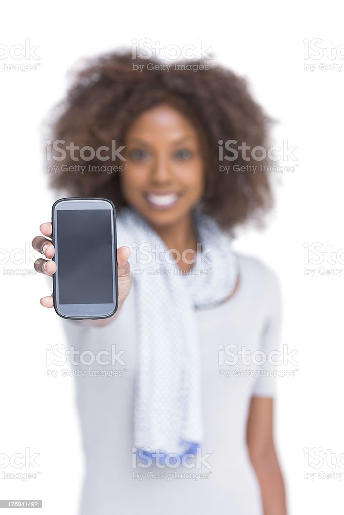 Cheerful woman showing her smartphone royalty-free stock photo