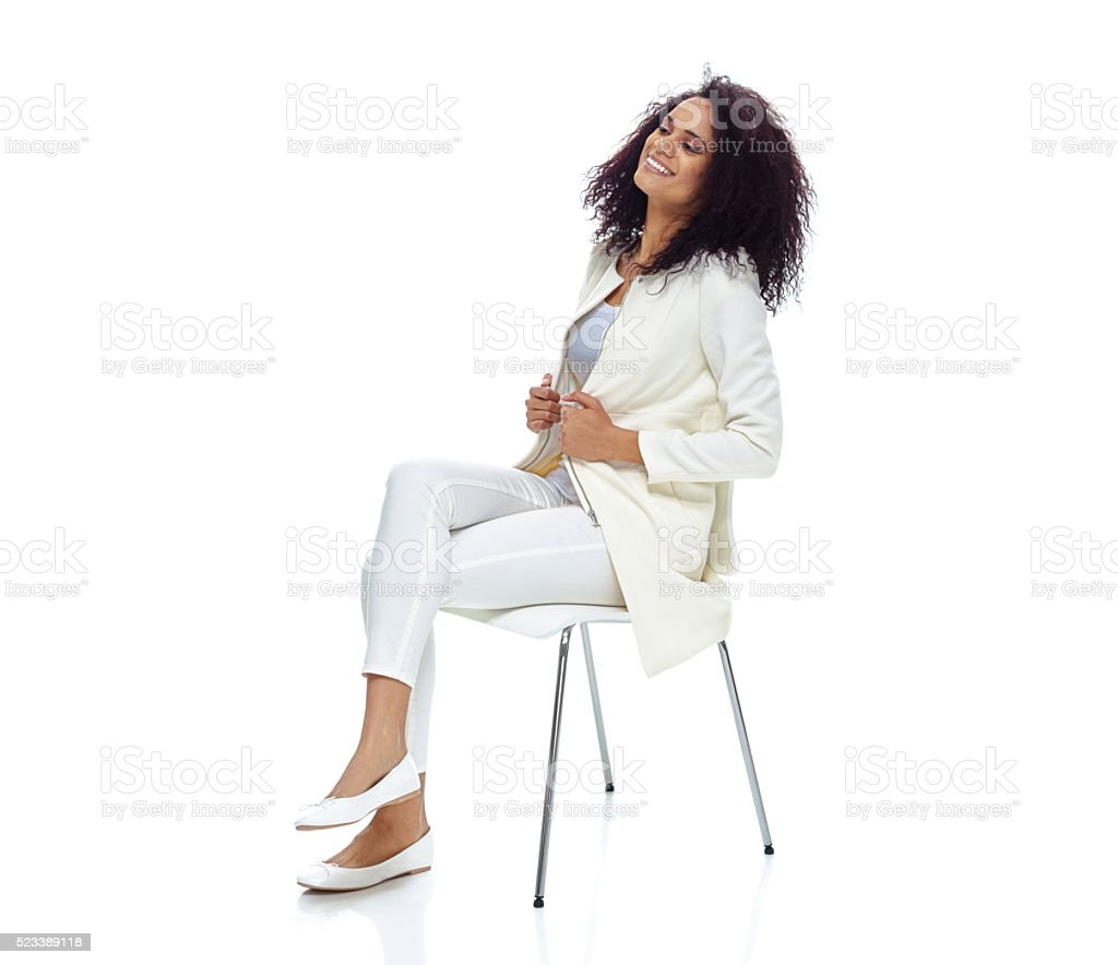 Cheerful woman sitting and looking away stock photo