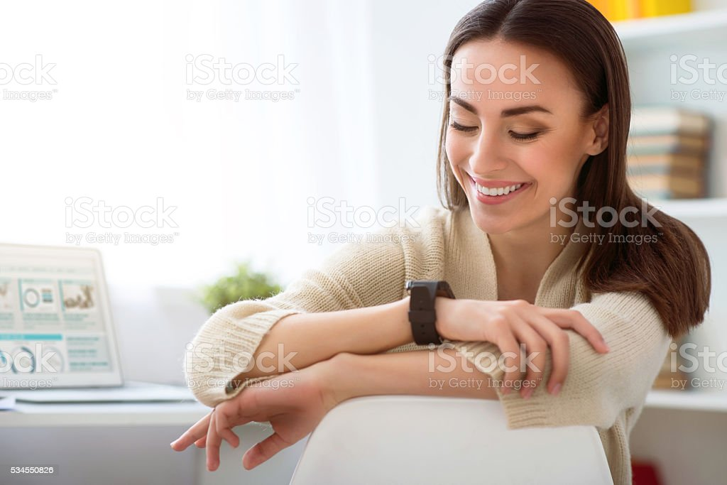 Cheerful woman sitting in the chair stock photo