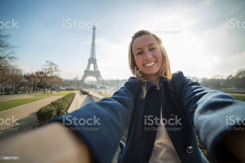 Cheerful woman takes selfie in Paris-Eiffel tower stock photo