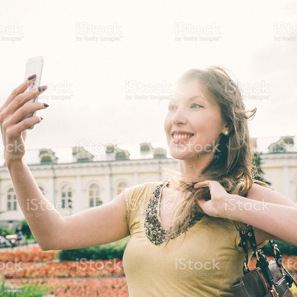 Cheerful Woman Taking A Selfie, Alexander Garden, Moscow, Russia stock photo