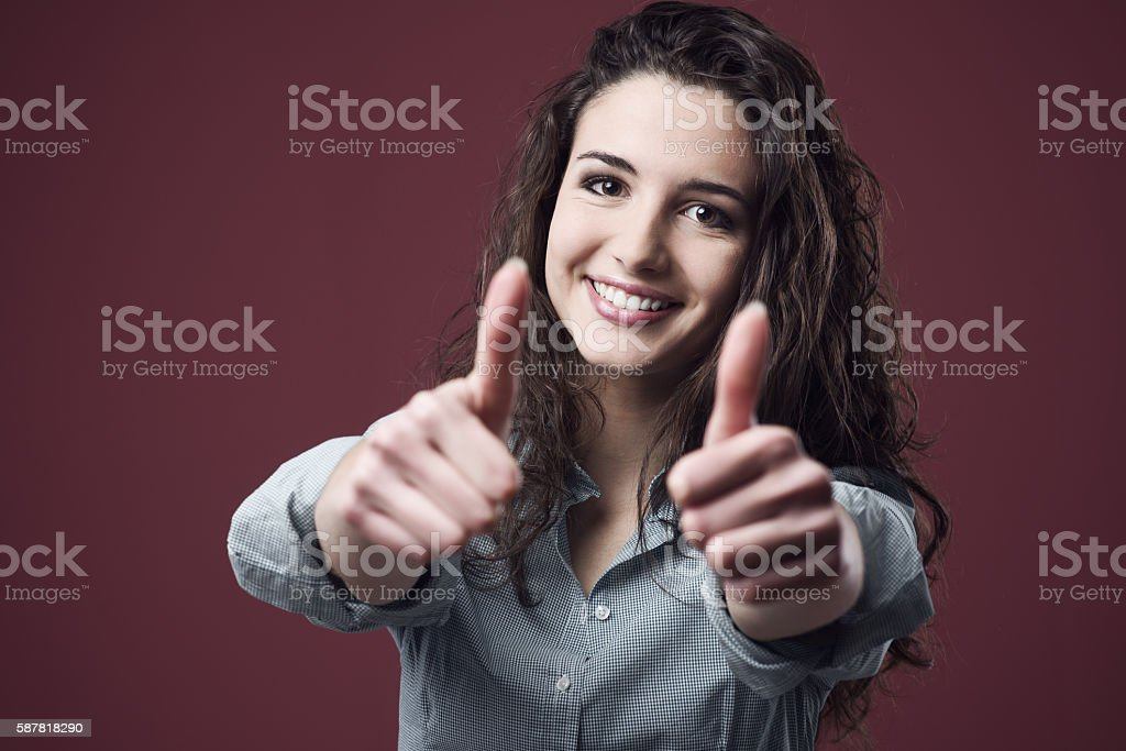 Cheerful woman thumbs up stock photo