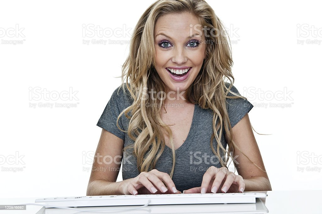 Cheerful woman using a computer royalty-free stock photo
