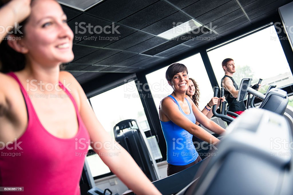 cheerful woman walking on the gym treadmill stock photo