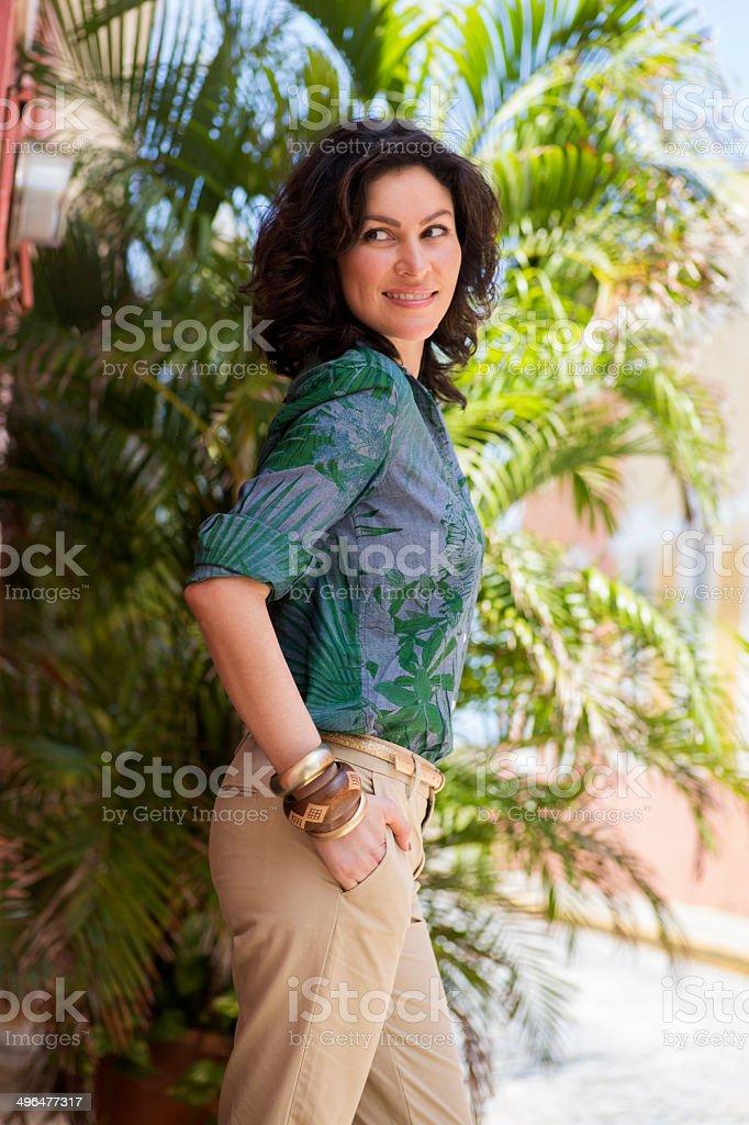 Cheerful woman wearing khakis stock photo