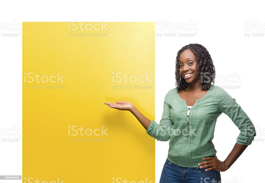 Cheerful woman with a yellow sign royalty-free stock photo
