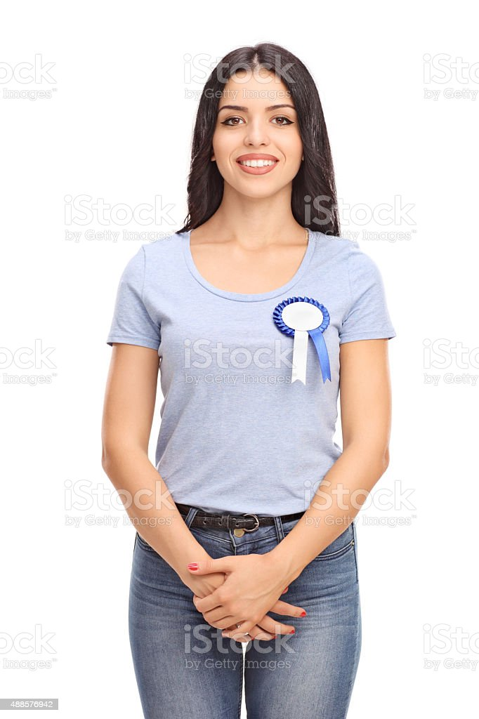 Cheerful woman with an award badge on her shirt stock photo