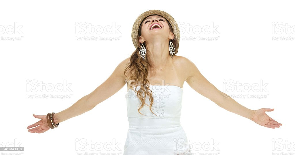 Cheerful woman with arm outstretched stock photo