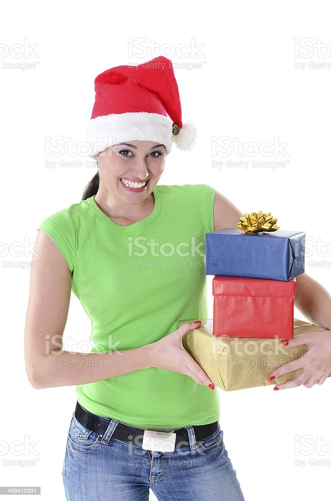 Cheerful woman with Christmas gifts and Santa's hat royalty-free stock photo