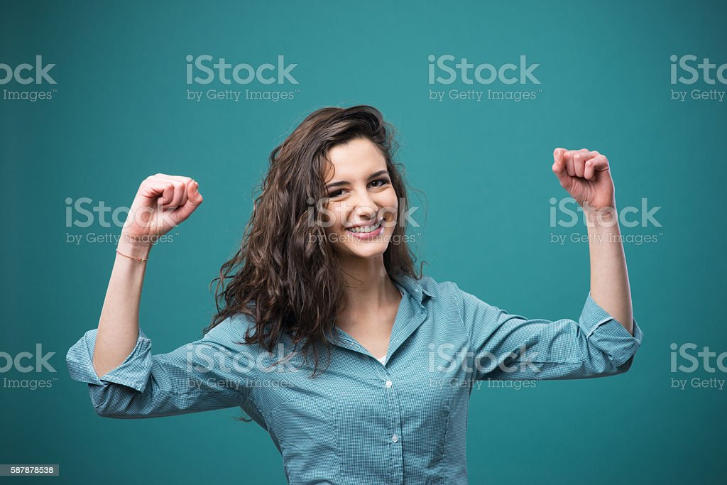 Cheerful woman with raised fists stock photo