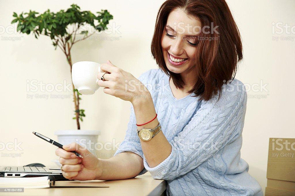 Cheerful woman working stock photo